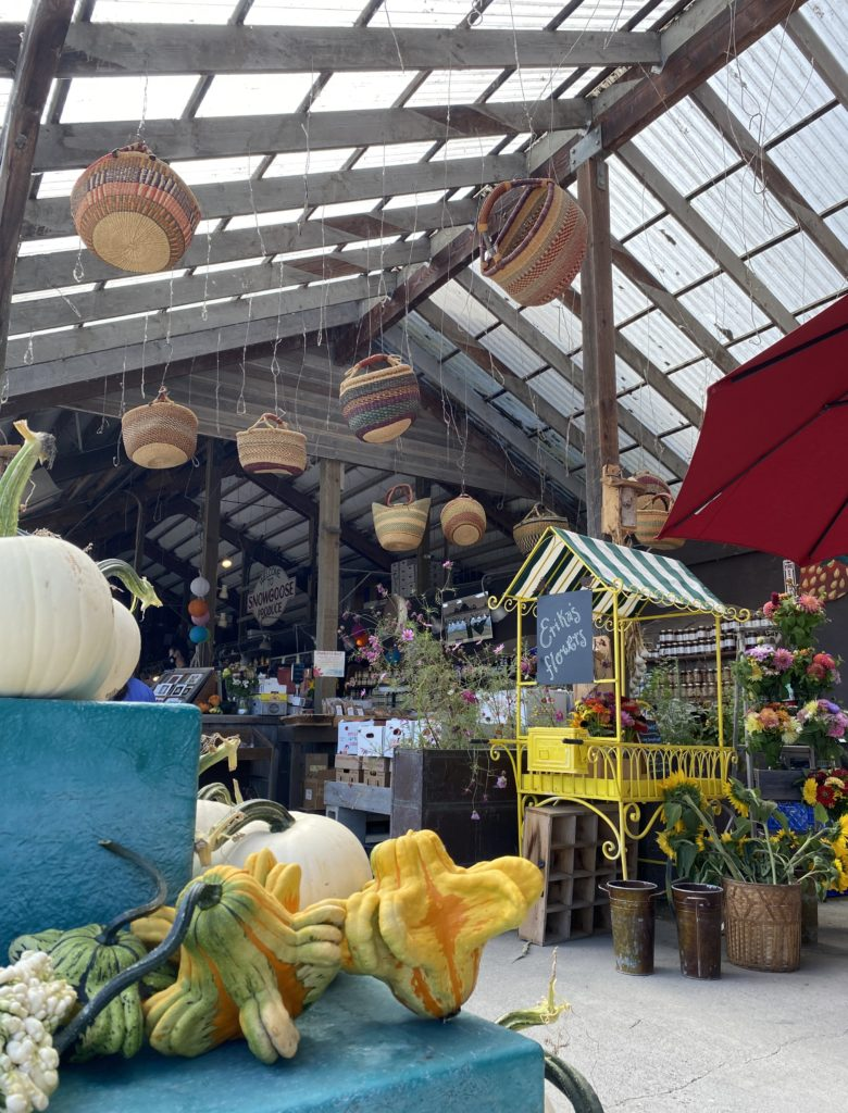 Woven baskets hang from roof of Snow Goose Produce stand in the Seattle area